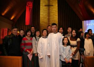 CLSBC's First Baptism Service. Mrs. Sun and her son Steve are baptized.