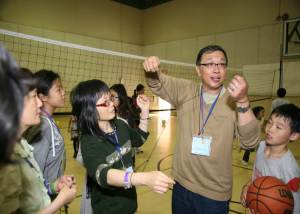 Pastor Kao leads games at Summer Retreat