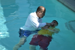 Pastor Hizon baptizing
