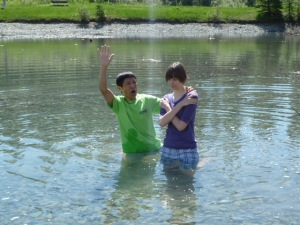 Pastor Yoichi of Crossover Japanese Church baptises Carly.